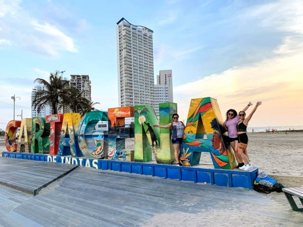 colorful giant cartagena sign girl poses