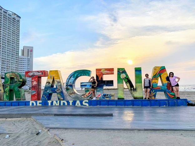 giant cartagena sign with beach in background