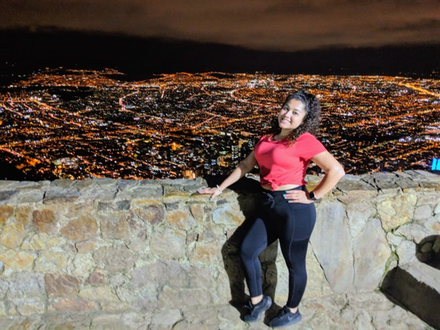woman posing at the top of monserrate at night
