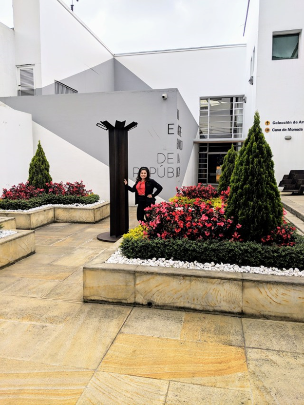 woman posing in garden outside of botero museum